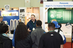 The Affordable Comfort Inc. (ACI) conference also included a trade show. Here, a crowd gathers in front of the Panasonic booth.