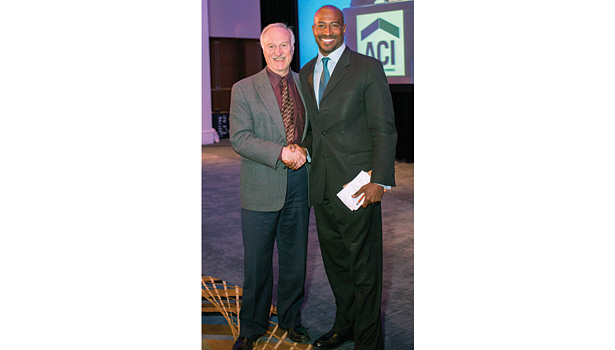 Conference keynote speaker Van Jones of CNN (right) poses with Steve Cowell, co-chairperson of the Home Performance Coalition board of directors (left).