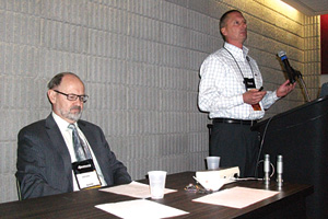 A presentation on ammonia refrigeration systems pressure relief venting is given by William Greulich of Kensington Consulting. Seated is Brian Marriott, who moderated the Q&A portion of the presentation.