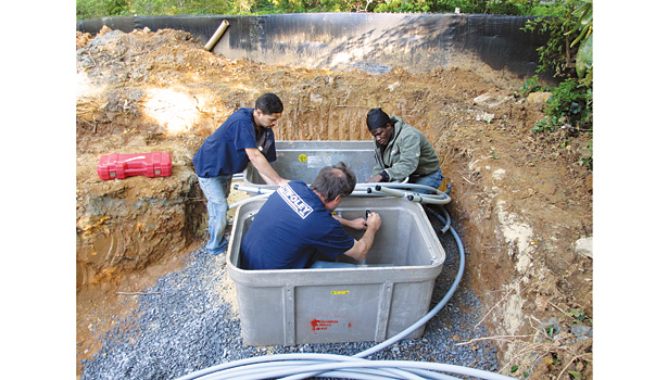 For this private residence in Bethesda, Maryland, Foley Mechanical technicians install geothermal manifolds in a concrete vault.