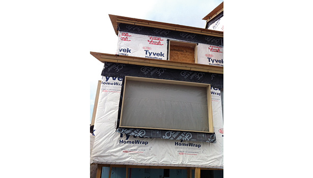 In many deep energy retrofits, the siding is stripped off and the home is wrapped with two layers of 2-inch rigid foam board.