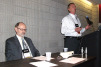 A presentation on ammonia refrigeration systemsâ?? pressure relief venting is given by William Greulich of Kensington Consulting. Seated is Brian Marriott, who moderated the Q&A portion of the presentation.