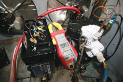 Figure 1. Frost coming back to an air-cooled compressor. Evaporator has more than nine degrees of superheat. Compressor has more than 25 degrees of total superheat.  (Photo courtesy of Ferris State University)