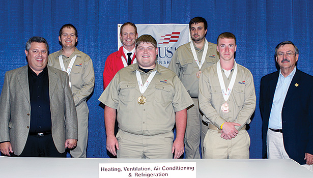 2014 SkillsUSA winners and committee members pose for a photo.