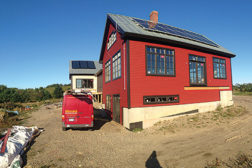 Insource Renewables, Pittsfield, Maine, installed photovoltaic (PV) panels as well as solar collectors for a combisystem (water and space heating) on the back roof of this home in Searsmont, Maine.