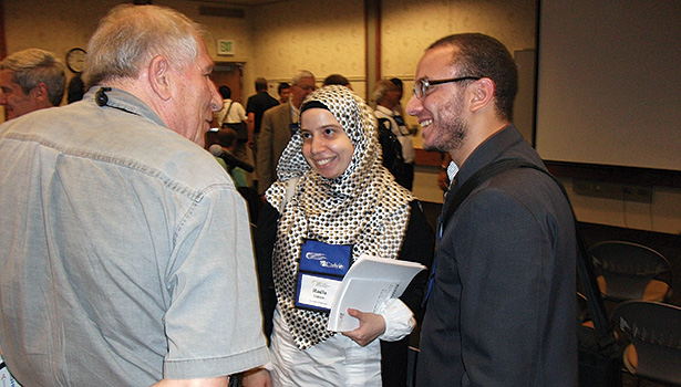 Radia Eldeeb, center, of the University of Maryland, speaks with attendees at a refrigerant seminar following her presentation of research done at the University of Maryland and King Saud University in Saudi Arabia.