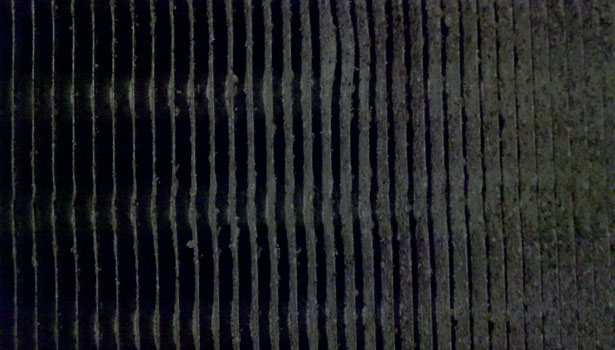 Shown is an extremely dirty cooling coil at Lackland Air Force Base before UV-C was installed.