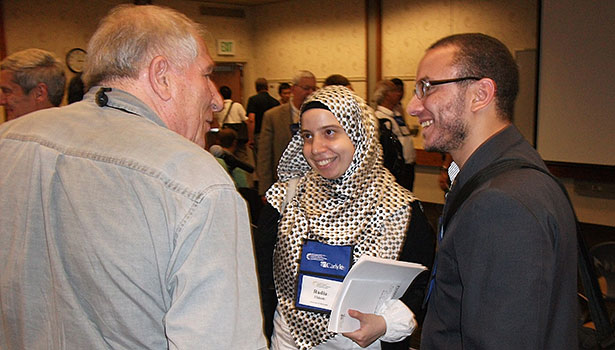 Radia Eldeeb, center, of the University of Maryland speaks with attendees at a refrigerant seminar following her presentation of research done at the UM and King Saud University in Saudi Arabia.