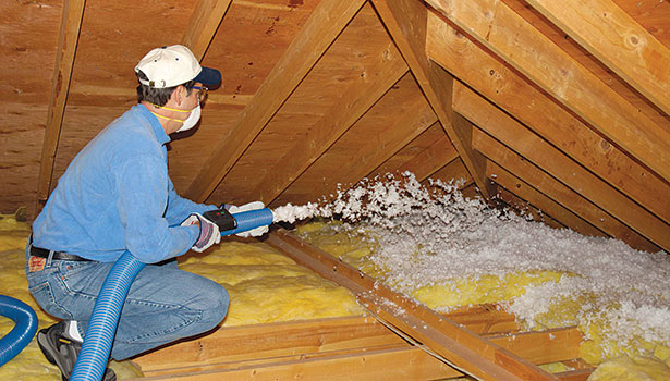 CertainTeedâ??s TrueComfort system, shown here in an attic retrofit, includes a blowing machine and fiberglass blown-in insulation.
