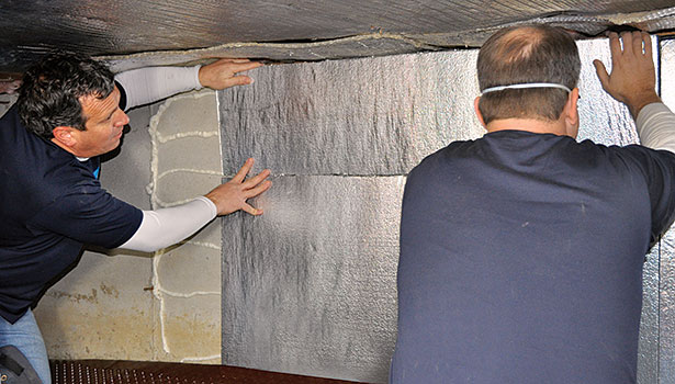 SilverGlo, a proprietary product available to Dr. Energy Saver dealers, is applied to crawlspace walls.
