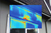 This thermal image shows air exfiltration above exterior window frame.