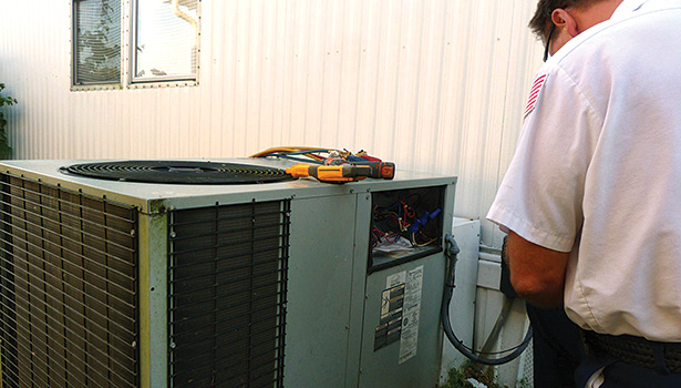 Repairing an aging air conditioning unit, such as the one shown here in Vero Beach, Florida, can be a costly venture that may need to be repeated in the future. (Photo courtesy of boxer_bob, http://bit.ly/RepVrep)