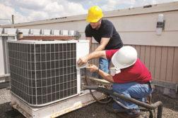 technicians working on a HVAC unit