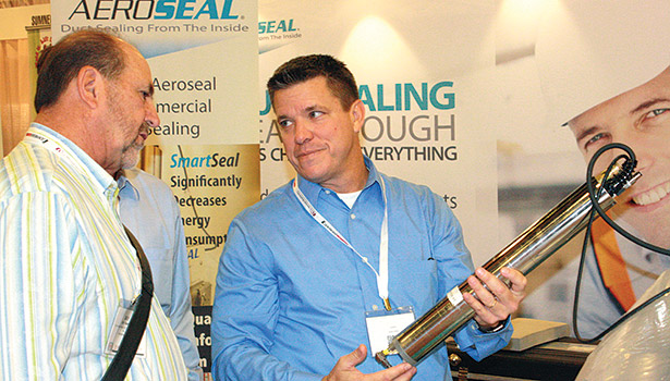 Contractor Ray Haase (left) learns more about duct sealing from Aerosealâ??s director of sales and marketing, commercial diviion, Bobby Seals (right).
