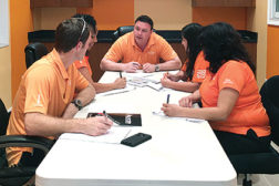 Rocco DiBenedetto meets with his management team at All Air of South Dade in Homestead, Florida. DiBenedetto has supplemented the cost of taking legal action against unlicensed contractors through his own marketing budget.