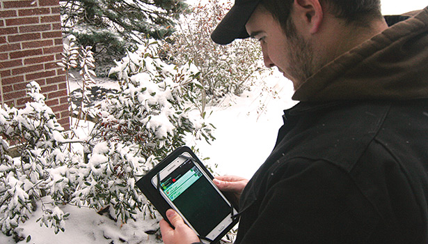 Figure 2. Another service technician remotely monitors system pressures with a tablet and an appropriately downloaded application from an outside unit two hours after refrigerant was added and freezing temperatures were achieved.