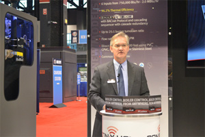 Mike Lahi, vice president, Sales & Marketing, Lochinvar, discusses the new condensing boiler during a press conference at AHR Expo in Chicago.
