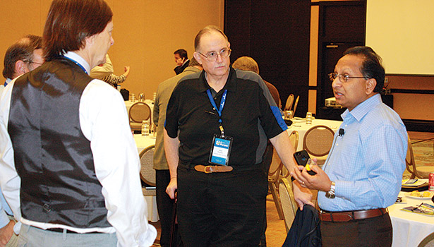 Rajan Rajendran (right) discusses refrigerants with Jon Dresser (middle), refrigeration specialist, Refrigeration Sales Corp. and others at the E360 Forum.