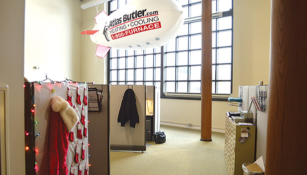 A small blimp floats through the sales area at Atlas Butlerâ??s main office.
