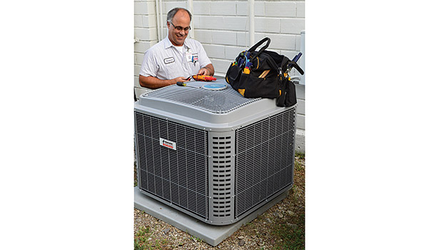 Richard Antinori, residential service technician, examines a unit. The company curently staffs more than 100 employees.