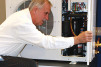 Keith Pohlman, president, All Temp Refrigeration Inc., examines the schematic of a demonstration compressor.