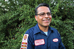 Elvis Coronado, Morflow Air Conditioning & Heating, San Fernando, California, showcases the patches he has earned from North American Technician Excellence(NATE).
