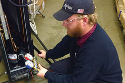Ryan Brown, a technician for AirTight Mechanical in Charlotte, North Carolina, services a portable R-22 system used for data center hot spots. (Photo courtesy of AirTight Mechanical)
