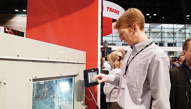 Bryan Elser, product manager, catalog airside products, Trane, a brand of Ingersoll Rand, demonstrates some of the brandâ??s newest technology at the 2015 AHR Expo in Chicago.