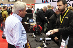 Andrew Micallef, product development engineer, General Tools & Instruments, discusses the companyâ??s latest offerings with an attendee at the 2015 AHR Expo.