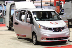 The Nissan booth showcased a variety of vehicles within its commercial fleet.