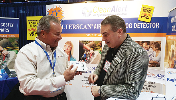 Terry Reavis (left), vice president of sales and marketing for CleanAlert, explains the FILTERSCANâ??s new Wi-Fi capabilities to Joel Williams, account director at Oâ??Reilly DePalma, during the 2015 AHR Expo in Chicago.