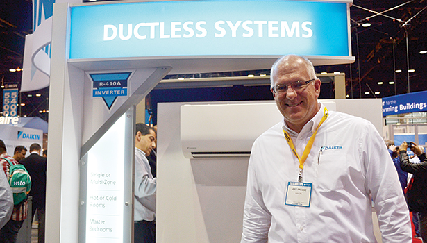 Jeff Freese, area sales manager, Daikin AC,  pauses his tour of the Daikin booth at AHR Expo in Chicago for a quick photo.