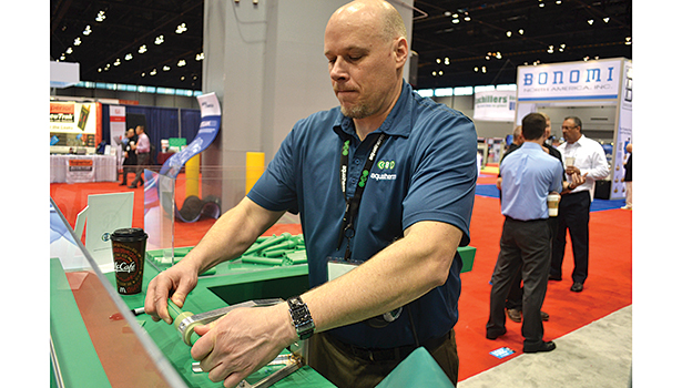 Barry Campbell, vice president, advertising and media relations, Aquatherm, demonstrates how Aquatherm systems are connected using heat fusion.