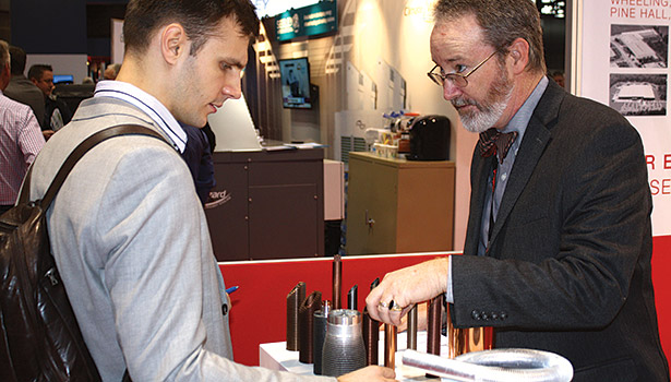 Oleg Goushcha (left), entrepreneurial lead, City College of New York, discusses the properties of copper welding with Scott Chilton, sales manager, Wieland Copper Products LLC.