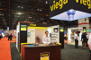 Dorothy Biggs, district sales manager, Viega, stands at the companyâ??s booth during the 2015 AHR Expo.