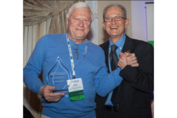 Aleks Roudnev, manager of research and design â?? applied hydraulics, Weir Minerals North America, accepts his 2014 Member of the Year Award