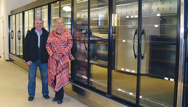 Mike Palotsee and Cathy Hattenbach pose with some of Hattenbach Co.â??s handiwork.