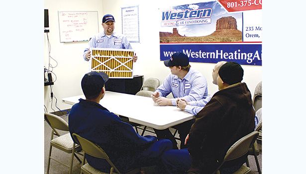 Western Heating & Air Conditioning offers varying incentives and prizes to employees. Company owner Ryan Snow (left) has been known to give people paid days off when he has observed them working extra hours.
