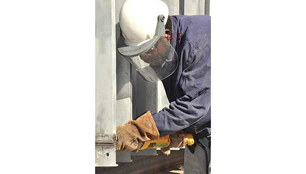 A plant worker welds together an air plenum designed to support the cascading ventilation system atop the Blue Grass Chemical Agent Destruction Pilot Plant Control and Support Building in Richmond, Kentucky.