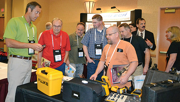 Several attendees of the HVAC Excellence conference stop by Flukeâ??s booth. More than 70 companies exhibited products at the show.