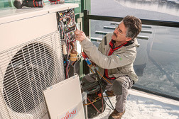 Dale Comeau, general manager of Comeau Refrigeration and Air Conditioning, Anapolis Royal, Nova Scotia, Canada, installs one of 79 Fujitsu RLXFZ units at Provident Developmentsâ?? Dockside Waterfront Drive condominium development.