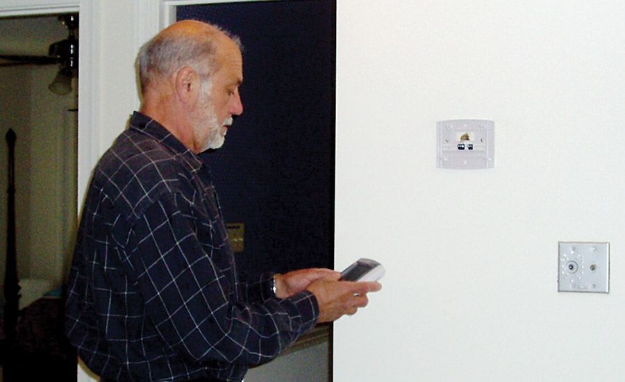 Peter Kusterer, owner, Air Comfort For Homes, Raleigh, North Carolina, sets a customerâ??s heat pump balance point as part of his checklist for a homeowner.