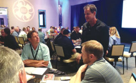 Tony Jeary (standing), author of 44 books on business and self-improvement, spoke to 200 Service Roundtable and Service Nation Alliance members during an annual International Roundtable meeting in Phoenix.