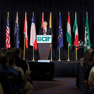 IIAR outgoing chairman Marcos Braz addresses IIAR members during the organizationâ??s 2015 business meeting. (Photo courtesy of IIAR)
