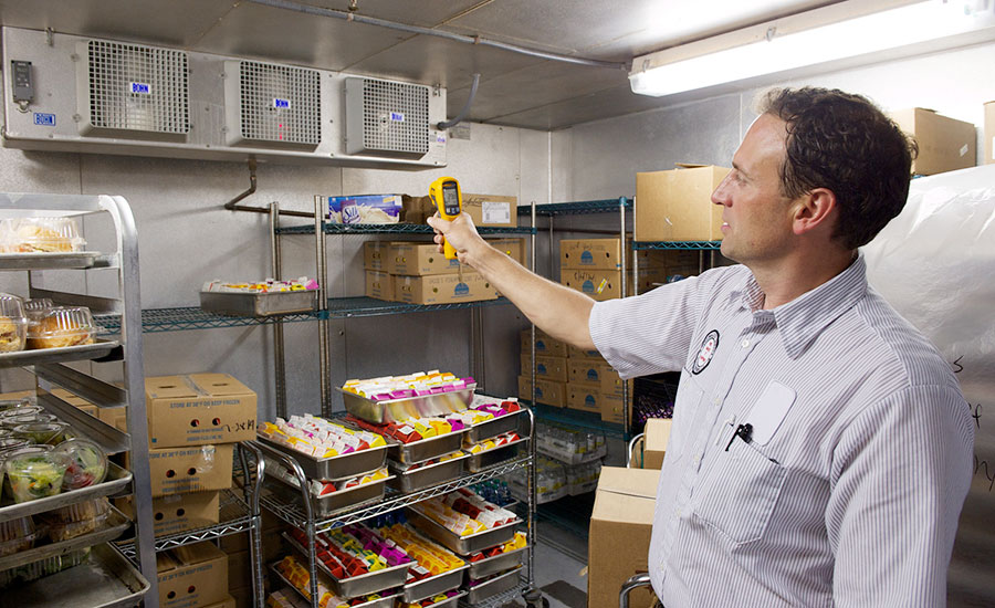 Mark Lord uses his 62 MAX infrared thermometer to check refrigeration units in a walk-in cooler, as part of his preventive maintenance program.