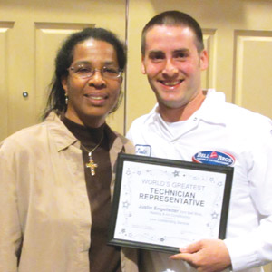 EXCEEDING EXPECTATIONS: At Bell Brothers, a customer presented her own award to technician Justin Engelleiter for providing great service and exceeding her expectations.