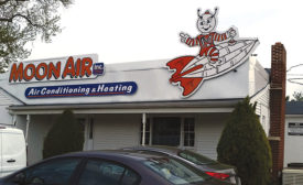 BRANDING YOUR BUSINESS: Steve Moon, owner of Moon Air Inc., admittedly loves his Moonman and displays the mascot everywhere, including on his building, trucks, signs, business cards, website, and more.
