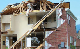 NATURAL DISASTER: A house stands torn apart after a tornado ripped through Hendersonville, Tennessee. Photo courtesy of Mike, http://bit.ly/ExWeather2