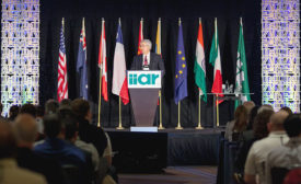IIAR outgoing Chairman Marcos Braz addresses IIAR members during the organization's 2015 business meeting.