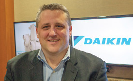 STAY CONNECTED: Paul Rauker, vice president and general manager, Daikin Applied, said the Internet of Things is part of his daily workload.